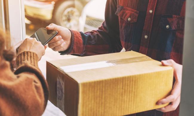 courier delivering a returns parcel
